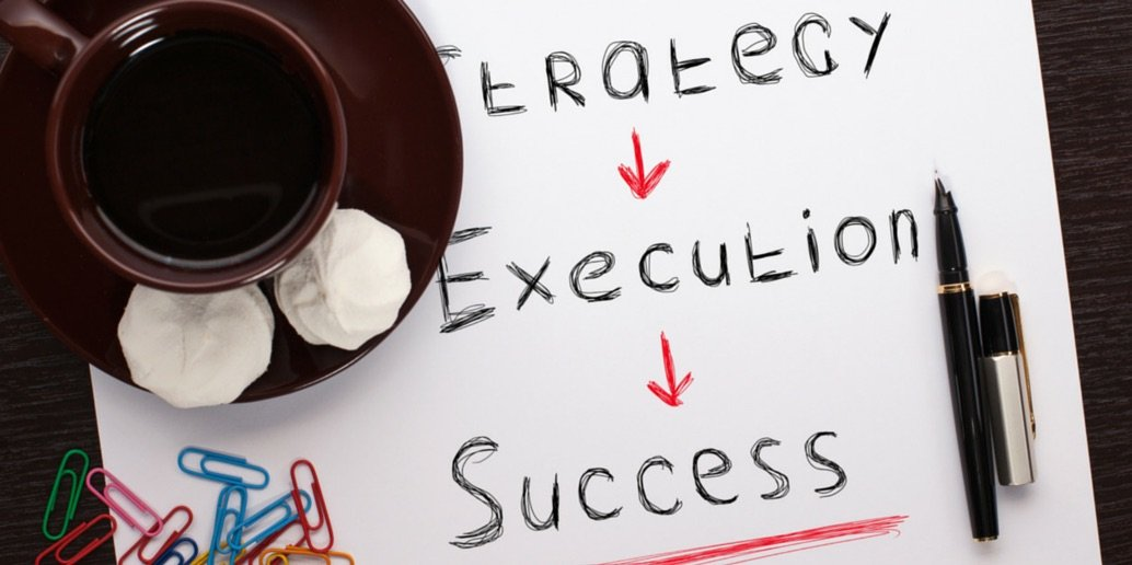 Image of written words on a page - Strategy, Execution and success