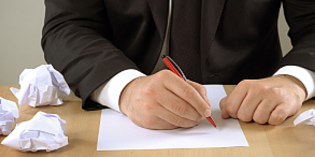 A man about to write a list of Goal Setting mistakes