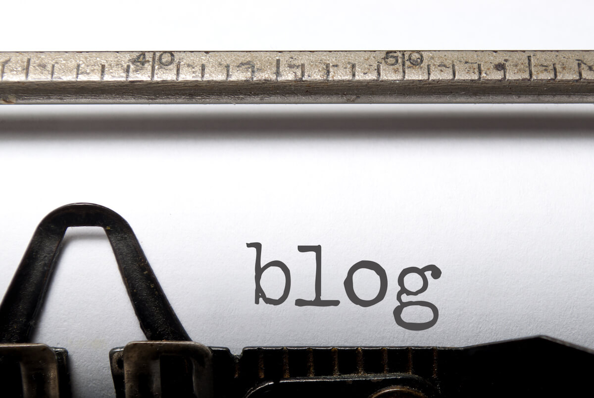 type writer with blog written on the page