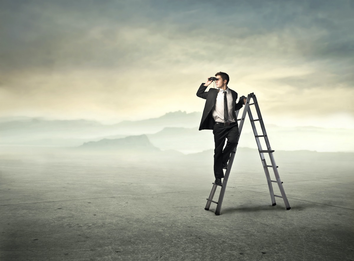 the future of work Businessman standing on a ladder and using binoculars