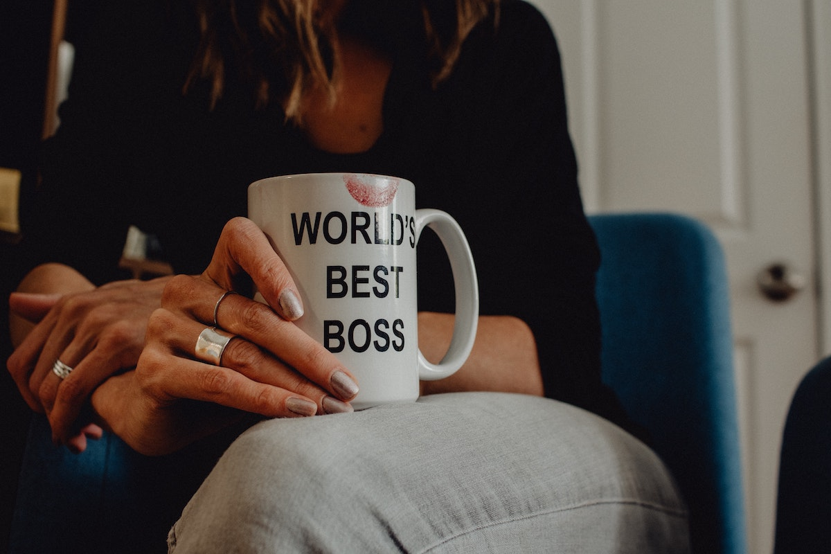 Trust Matters – Why is it so important in the workplace? woman wityh mug saying worlds best boss